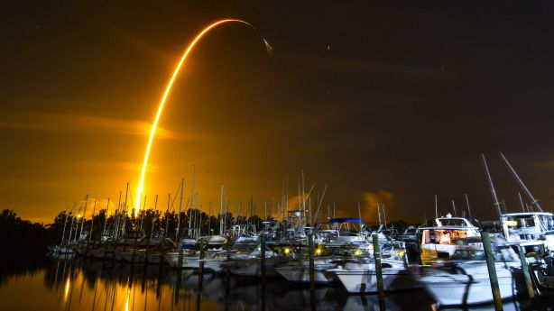 This long exposure photo shows the launch of a SpaceX Falcon 9 rocket on a resupply mission for NASA to the International Space Station from Pad 39A at Kennedy Space Center, seen from Merritt Island, Fla., Sunday.